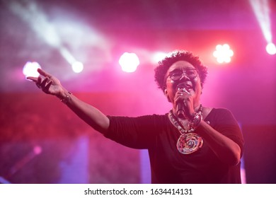 SANTO DOMINGO/DOMINICAN REPUBLIC- FEBRUARY 2, 2020: Xiomara Fortuna, dominican singer and composer, stands onstage with colorful lights in the background during Santo Domingo Pop festival.