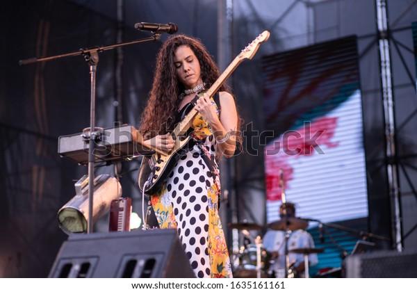 SANTO DOMINGO/DOMINICAN REPUBLIC- FEBRUARY 2, 2020: Dominican singer La Marimba plays guitar onstage during Santo Domingo Pop festival at National Botanical Garden.