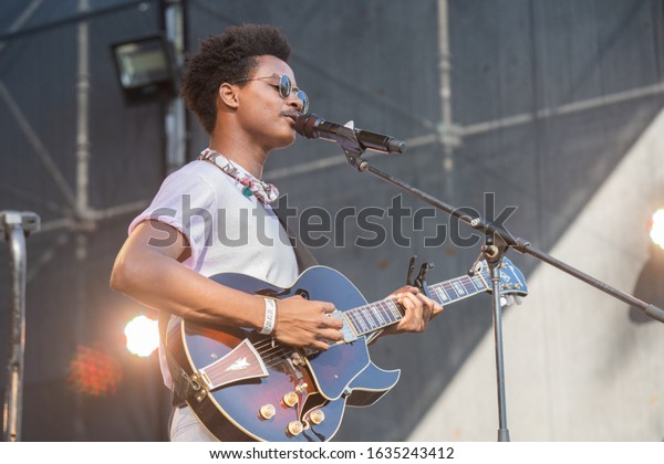 SANTO DOMINGO/DOMINICAN REPUBLIC- FEBRUARY 2, 2020: Dominican Republic music band Pororó main singer plays guitar onstage during Santo Domingo Pop festival at National Botanical Garden.