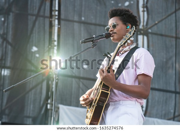 SANTO DOMINGO/DOMINICAN REPUBLIC- FEBRUARY 2, 2020: Dominican music band Pororó main singer plays guitar onstage during Santo Domingo Pop festival 2020