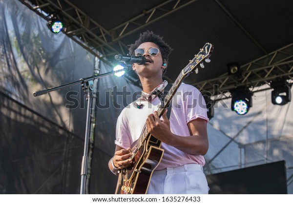 SANTO DOMINGO/DOMINICAN REPUBLIC- FEBRUARY 2, 2020: Main singer of Dominican music band Pororó  plays guitar onstage during Santo Domingo Pop festival at National Botanical Garden.