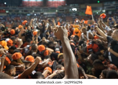SANTO DOMINGO/DOMINICAN REPUBLIC- JANUARY 28, 2020: Closed fist raised from the crowd after the Dominican Baseball League final between Toros del Este and Tigres del Licey at Quisqueya Stadium.