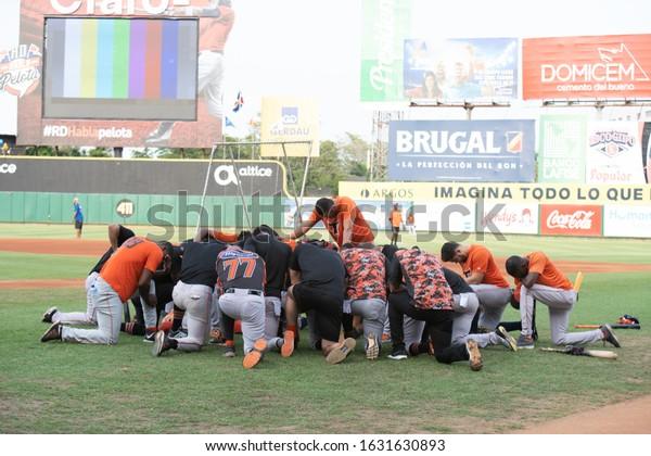 SANTO DOMINGO/DOMINICAN REPUBLIC- JANUARY 28, 2020: Toros del Este baseball team praying before victory game against Licey  at  Quisqueya Stadium Juan Marichal. The team pass to Caribbean Series.