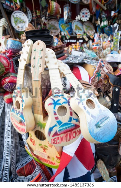 SANTO DOMINGO/DOMINICAN REPUBLIC - JUNE 1, 2019: Craft store in Calle El Conde (Colonial Zone) selling wooden toy guitars, dominican flag, handmade wallets and typical decorative objects.