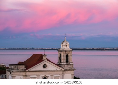 Santo Estevao Church from Mirador Alama Lisbon at sunset