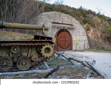 Sant'Oreste, Italy - 01 13 2019: M55 self propelled howitzer in front of the entrance of the fallout shelter beneath Mount Soratte.
