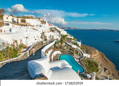 Santorini Greece- 06-05-2016-View of Oia city in sunny weather. The background is a blue sky with white clouds.