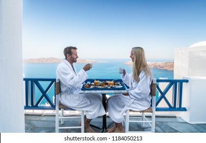 Santorini, Greece - 19 September, 2017: Travel Blogger Couple enjoying a breakfast in Santorini.
