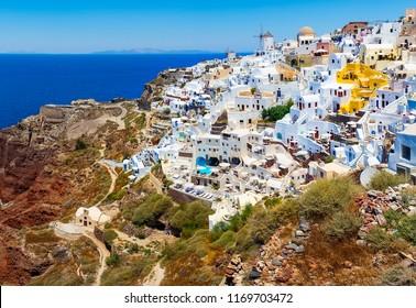 Santorini, Greece. Famous attraction of Oia village with windmill in Greek Islands, Aegean Sea.