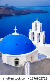 Santorini, Greece. Firostefani blue church and Aegean Sea, Greek Islands.