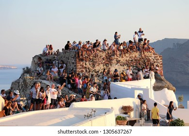 SANTORINI, GREECE - JULY 19, 2018: picturesque village of Oia crowded of tourists for the sunset show, Santorini island, Greece