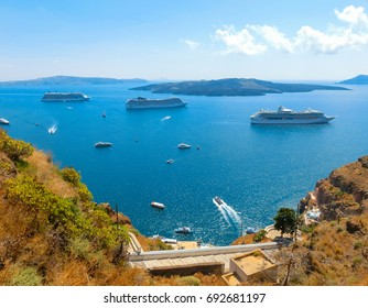 Santorini, Greece - June 10, 2015 : The beautiful view of marina with cruise ships on the sea