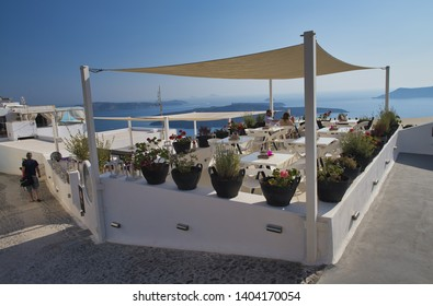 SANTORINI, GREECE - JUNE 2014: Sunset view of Oia restaurant over the sea. Oia is the major tourist attraction on the island.