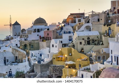 SANTORINI, GREECE - JUNE 2014: Sunset view of Oia buildings and streets. Oia is the major tourist attraction on the island.