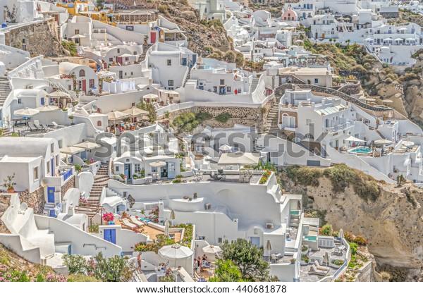 SANTORINI, GREECE - May 30, 2016: Beautiful complex multi-level architecture of Oia town on Santorini, Greece. Santorini's unique landscape makes it a popular tourist destination in the Greek islands.