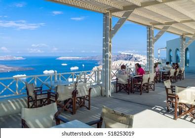 Santorini, Greece - October 13, 2012:  Tourists in a wine house near Pirgos village