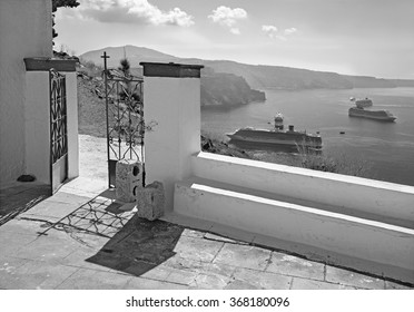 SANTORINI, GREECE - OCTOBER 7, 2015: The outlook over the gate of little chapel under Skaros castle in Imerovigili to caldera with the cruises