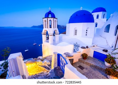 Santorini, Greece. Oia white village with cobbled paths, greek orthodox blue church.