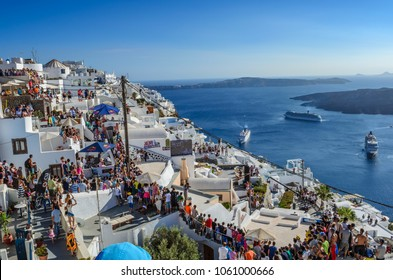 SANTORINI, GREECE SEPTEMBER 2013: Tourists and visitors wait to see a unique parkour show from athlets around the world in Santorini Island, Greece. Free to public show in Santorini, Cyclades, Greece