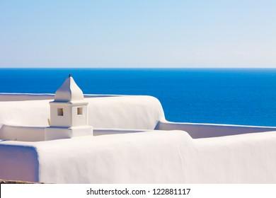 Santorini Greece, White chimney above sea at Santorini island in Greece