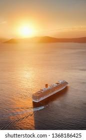 Santorini island with cruise ship at sunset in Greece.