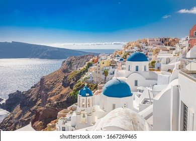 Santorini island, Greece. Incredibly romantic summer landscape on Santorini. Oia village in the morning light. Amazing view with white houses. Island of lovers, vacation and travel background concept