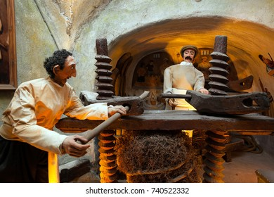 Santorini Island, Greece - July 19, 2012: Koutsoyannopoulos Winery and Wine Museum in Vothonas. In the cellars there are ancient objects and figures about how wine was produced in ancient times.