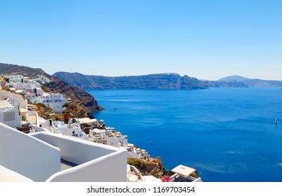 Santorini island, Greece: Landmark detail of terrace decorated with flowers over the caldera Caldera