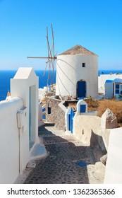 Santorini island with traditional windmill in Greece.