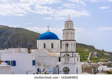 Santorini landscape with traditional whitewashed Agios Nikolaos Church in Pyrgos, Greece