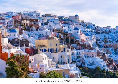 Santorini landscape with view of whitewashed buildings and churches in Oia, Greece