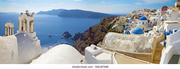 Santorini - The panorama of Oia and the Therasia island in the background.