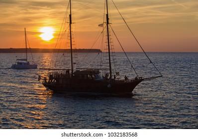 Santorini - The sailer silhouette in sunset.