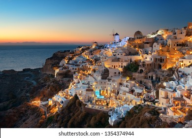 Santorini skyline at night after sunset with buildings in Greece.
