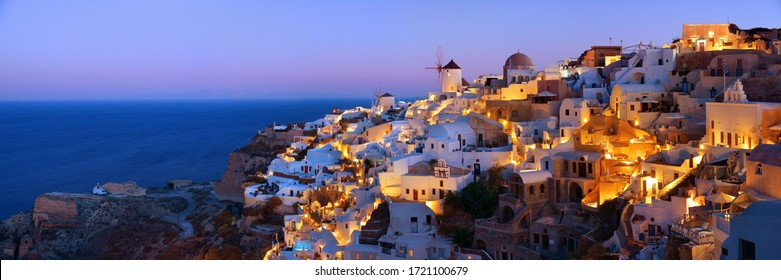 Santorini skyline at night with buildings in Greece.