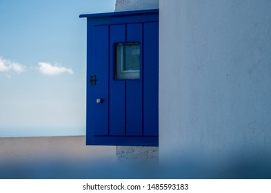 Santorini typical blue painted details in the city of Oia, Greece, wooden wall cabin