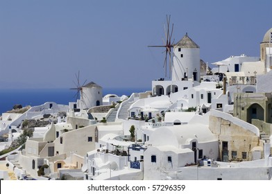 Santorini view with two windmills