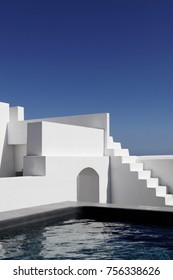 Santorini White stairs and a pool on a villa