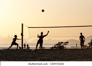 Santos, Brazil - March 01, 2012: group of young people playing footvolley on the beach