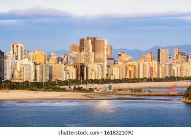 Santos - SP, Brazil - November 21, 2019: Aerial view of Santos SP Brazil, Jose Menino beach, Paulista coast. View of the undersea emissary and the buildings of the city.