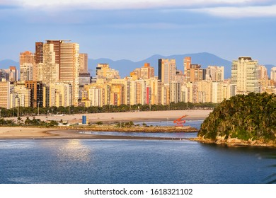 Santos - SP, Brazil - November 21, 2019: Aerial view of Santos SP Brazil, Jose Menino beach, Paulista coast. View of the island, the undersea emissary and the buildings of the city during the day.