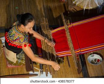 Santubong,Sarawak,Malaysia-December 14,2015:Undentified of Iban women at Rumah Panjang Iban, Kampung Budaya, Sarawak,Malaysia.
