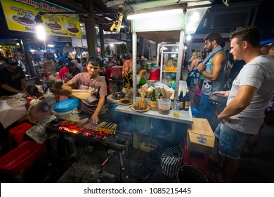 Sanur, Bali / Indonesia - December 28 2017: Scene of a worker at the local night market with customer surrounding