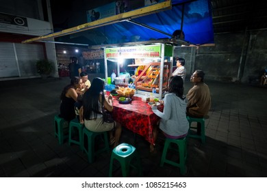 Sanur, Bali / Indonesia - December 28 2017: Customers eating at a food stand at the local night market