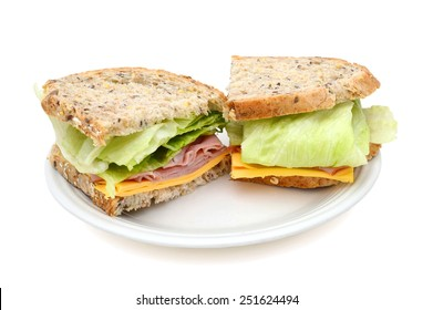 sanwich with ham, cheese, salad on plate