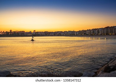 Sanxenxo seafront and inlet at golden dusk reflected on the sea