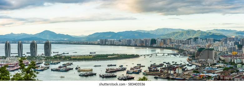 SANYA, CHINA - 21 NOVEMBER 2016: Bird eye panorama of the Sanya city bay with green mountains in the horizon. View from Luhuitou Park on Hainan Island of China.