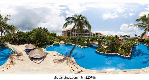SANYA, CHINA - JUNE 5, 2015: Full 360 degree panorama in equirectangular spherical projection with pools and palm trees. Photorealistic VR content
