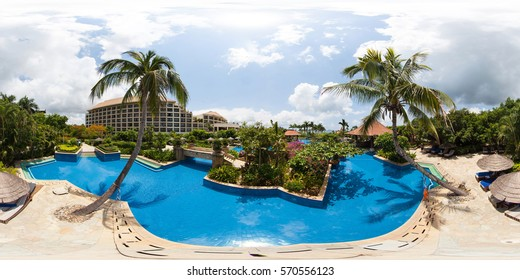 SANYA, CHINA - JUNE 5, 2015: Full 360 degree panorama in equirectangular spherical projection with pools and palm trees and luxury hotel. 50 Mpx. Photorealistic VR content