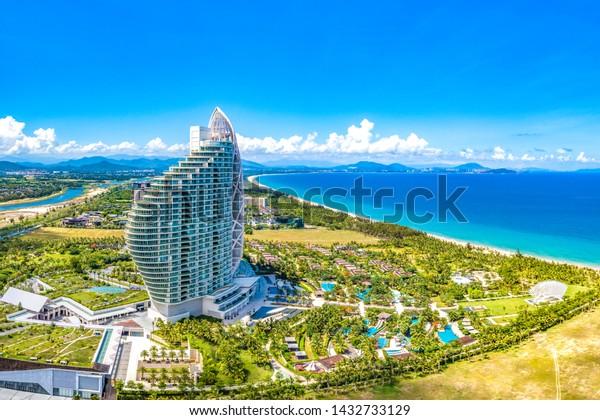 Sanya, Hainan, China - June 7th, 2019: Sanya Haitang Bay Mangrove Tree Resort, Landmark Luxurious Hotel Building Shaped like a Sea Shell, Facing the South China Sea of Pacific Ocean. Aerial View.